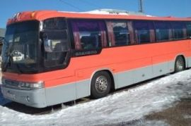 Перевозка людей на автобусе Neoplan Коелга