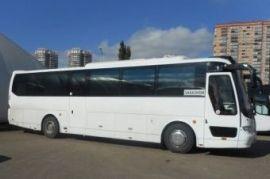 Перевозка людей на автобусе Neoplan Белый